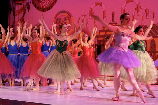 "Emilie Kushner, center, from New Canaan performs in 2008 in ""The Nutcracker."" It was seven years after she had started performing in the classic tale. By the time she attained the part of the older Clara this year for the the New England Academy of Dance and New England Dance Theater's 2012 production of ""The Nutcracker"" she had already played more than a dozen characters. Photo: Contributed Photo"