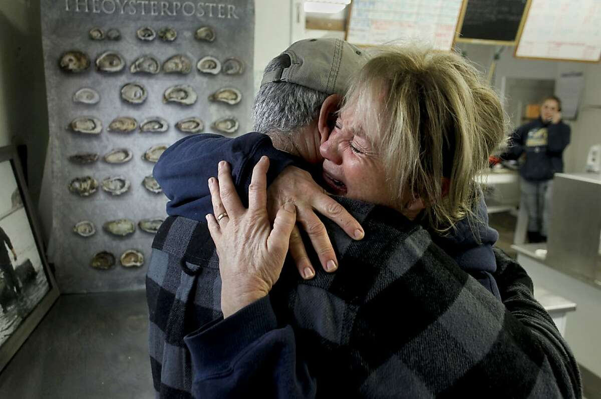 The owner of the Drakes Bay Oyster Company Kevin Lunny is embraced by his sister Ginny Lunny-Cummings, the farm manager, after hearing earlier in the morning of the lease not being renewed on Thursday Nov. 29, 2012, in Point Reyes, Calif. U.S. Interior Secretary Ken Salazar rejected a proposal to extend the lease of the popular Drakes Bay Oyster Farm at Point Reyes National Seashore Thursday, effectively ending more than a century of shellfish production on the 1,100 acres in Drakes Bay.