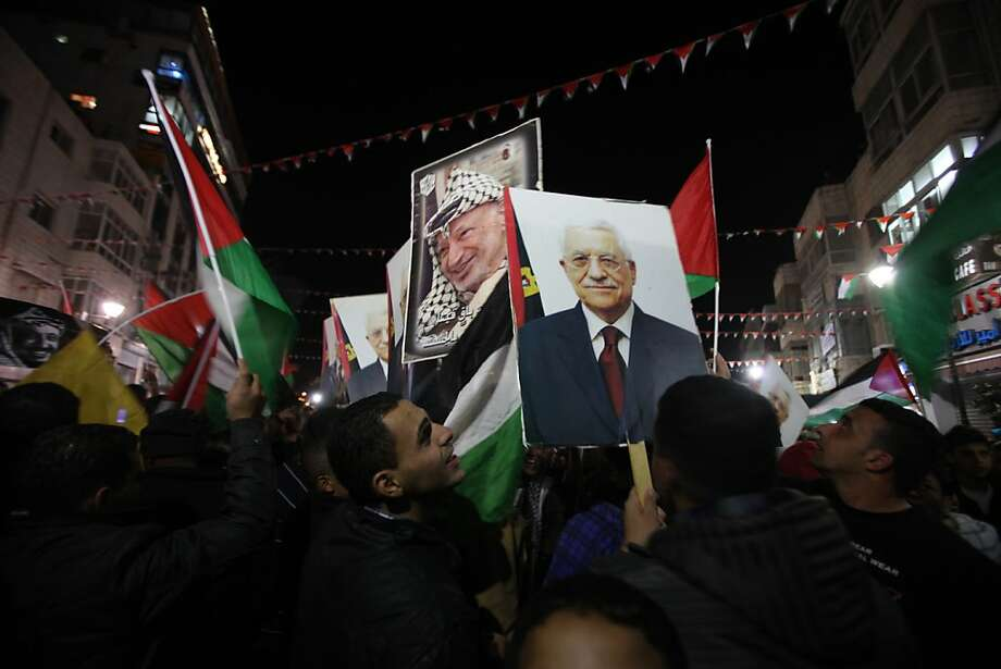 Palestinians celebrate in the West Bank city of Ramallah on November 29, 2012 after the General Assembly voted to recognise Palestine as a non-member state. The UN General Assembly on Thursday voted overwhelmingly to recognize Palestine as a non-member state, giving a major diplomatic triumph to president Mahmud Abbas despite fierce opposition from the United States and Israel. Photo: Abbas Momani, AFP/Getty Images