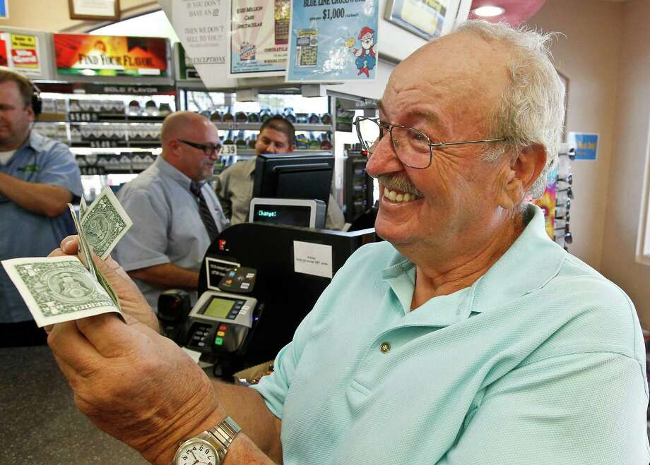 Wes Prinzen smiles over his $4 winnings at the 4 Sons Food Store where a winning ticket was sold. Photo: Ross D. Franklin, STF / AP