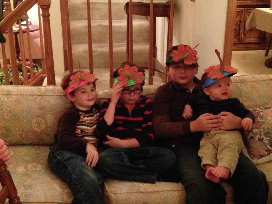 Annette Beauchaine of Albany snapped this photo of her great grandchildren wearing turkey caps for the holiday. They are Jason Wolfgang, 5; Nolan Wolfgang, 6 and Austin Wolfgang, 11, all from Albany, and Greyson Beauchaine 9-months-old from Rochester.  (Craig Beauchaine)