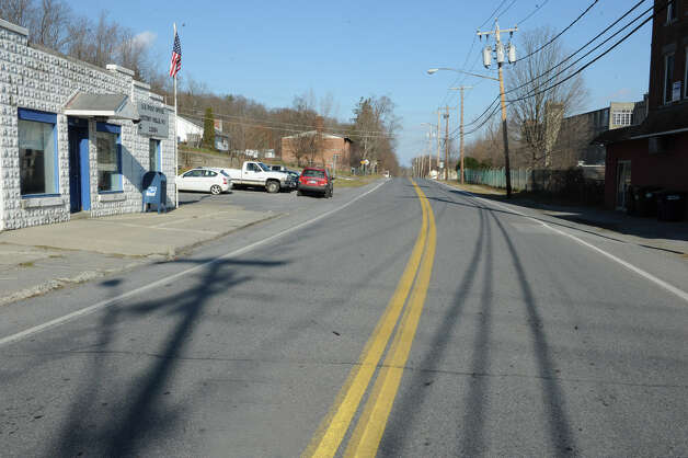 The main road running through Victory with the post office on the left and the large (now defunct) factory/mill Saratoga Victory Manufacturing Company on the right in the Village of Victory Thursday Nov. 29, 2012 in Victory, N.Y.  (Lori Van Buren / Times Union archive) Photo: Lori Van Buren