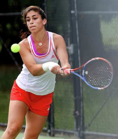 Greenwich High School's Jenn DeLuca looks to return a serve from opponent Courtney Gallagher of New Canaan High School during Class L tennis finals on Friday June 1, 2012 at Yale's Cullman Courts in West Haven, Conn. Photo: Mike Ross / Connecticut Post Freelance