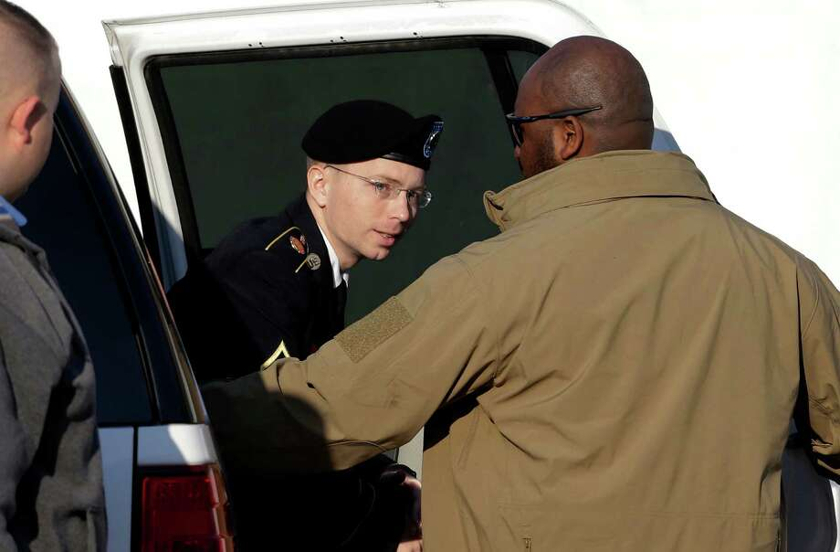 Army Pfc. Bradley Manning steps out of a security vehicle as he is escorted into a courthouse in Fort Meade, Md., Thursday, Nov. 29, 2012, for a pretrial hearing. Manning is charged with aiding the enemy by causing hundreds of thousands of classified documents to be published on the secret-sharing website WikiLeaks. (AP Photo/Patrick Semansky) Photo: Patrick Semansky, STF / AP