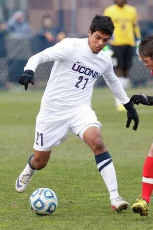 Nic Zuniga dribbles the ball for UConn. Zuniga, a Norwalk grad, scored the game-winning goal for the Huskies in a  2-1 double overtime victory over New Mexico in the third round of the NCAA tournament last Sunday in Storrs. November 2012 Steve Slade/UConn Athletics Photo: Contributed Photo, Steve Slade/UConn Athletics / Stamford Advocate Contributed
