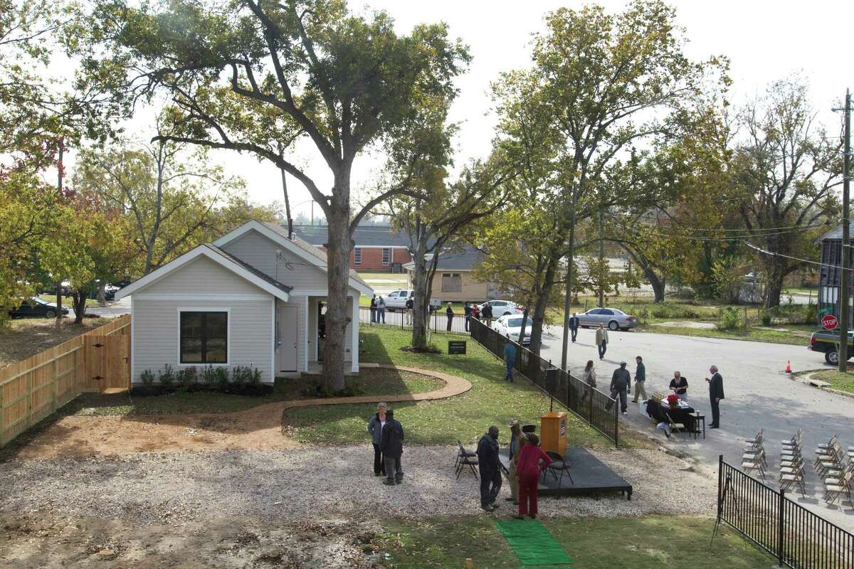 """Visitors tour one of two new homes by Houze - the last two letters stand for """"zero energy"""" - Thursday in Independence Heights. Developer David Goswick is touting an energy-wise next generation building system."""