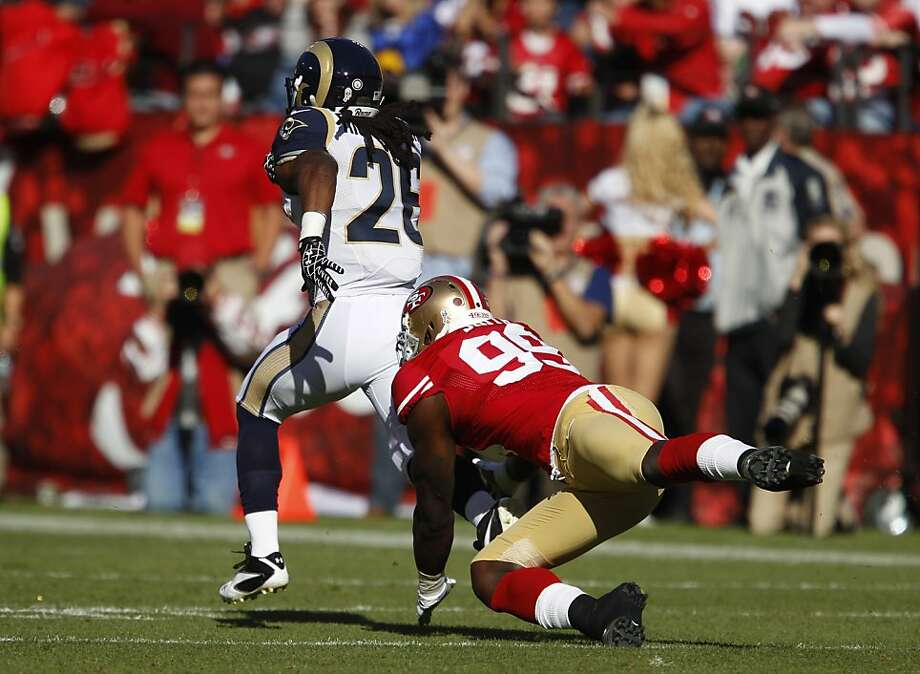 Daryl Richardson tries to elude Aldon Smith on Nov. 11 at Candlestick. Richardson gained 58 yards in the 24-24 tie. Photo: Carlos Avila Gonzalez, The Chronicle