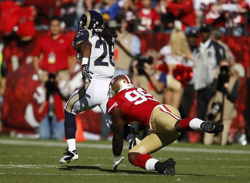 Daryl Richardson tries to elude Aldon Smith on Nov. 11 at Candlestick. Richardson gained 58 yards in