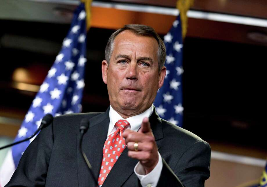 "House Speaker John Boehner of Ohio gestures as he speaks to reporters on Capitol Hill in Washington, Thursday, Nov. 29, 2012, after private talks with Treasury Secretary Timothy Geithner on the fiscal cliff negotiations. Boehner said no substantive progress has been made between the White House and the House"" in the past two weeks.  (AP Photo/J. Scott Applewhite) Photo: J. Scott Applewhite, STF / AP"