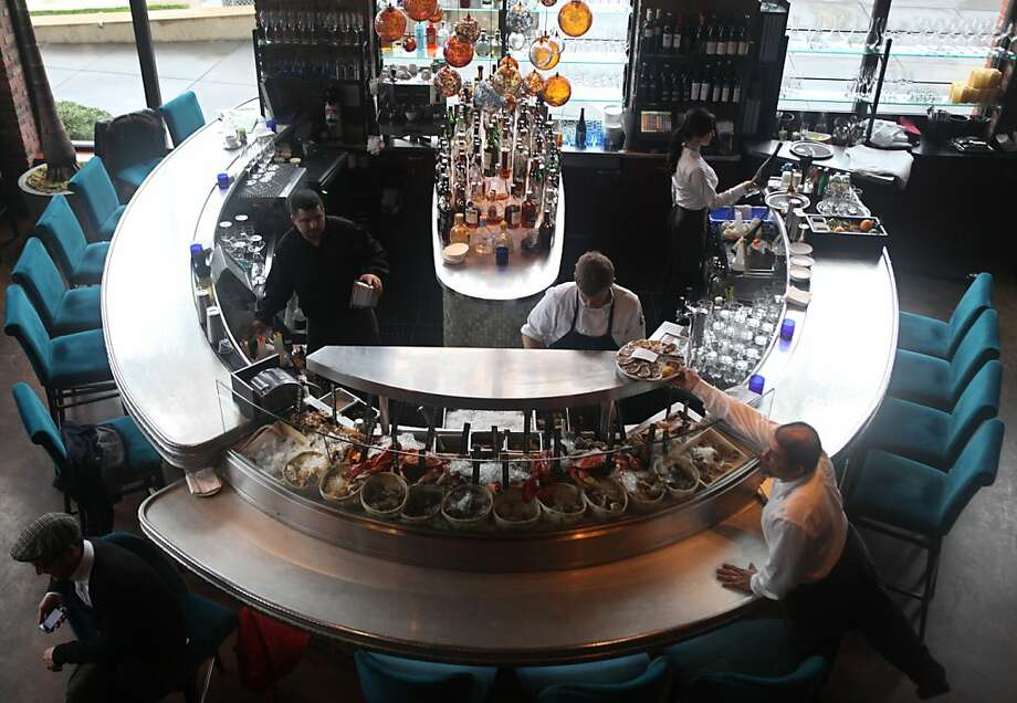 Eddy Acevedo grabs an order of oysters at Waterbar in San Francisco (left). Photo: Pete Kiehart, The Chronicle