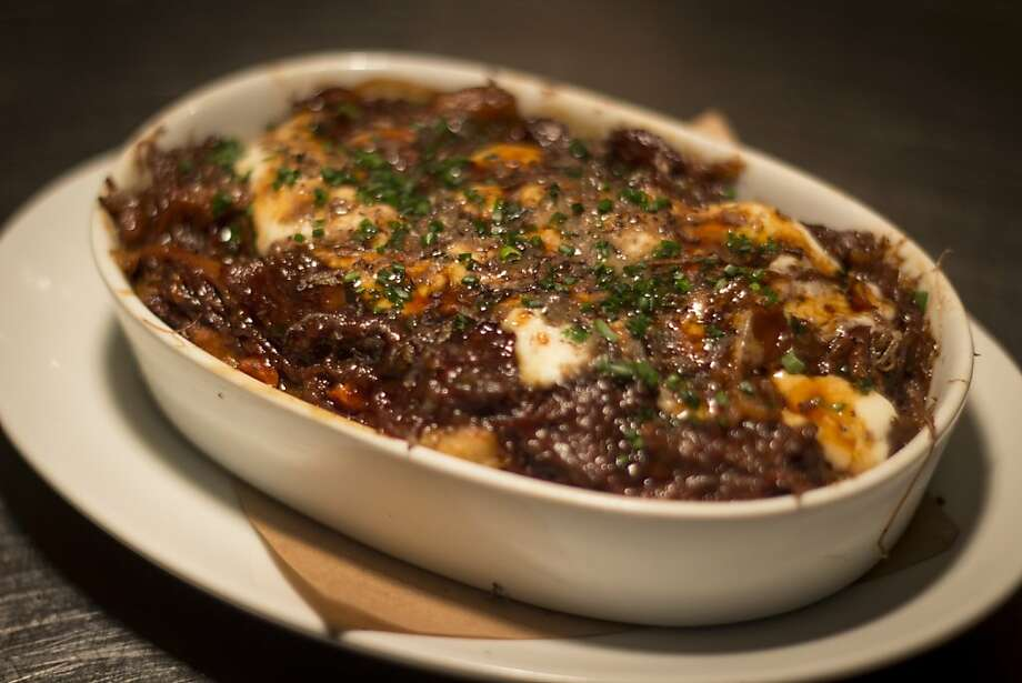 The poutine at Wayfare Tavern in San Francisco features oxtails and truffles. Photo: Simon F. F. Young, The San Francisco Chronicle