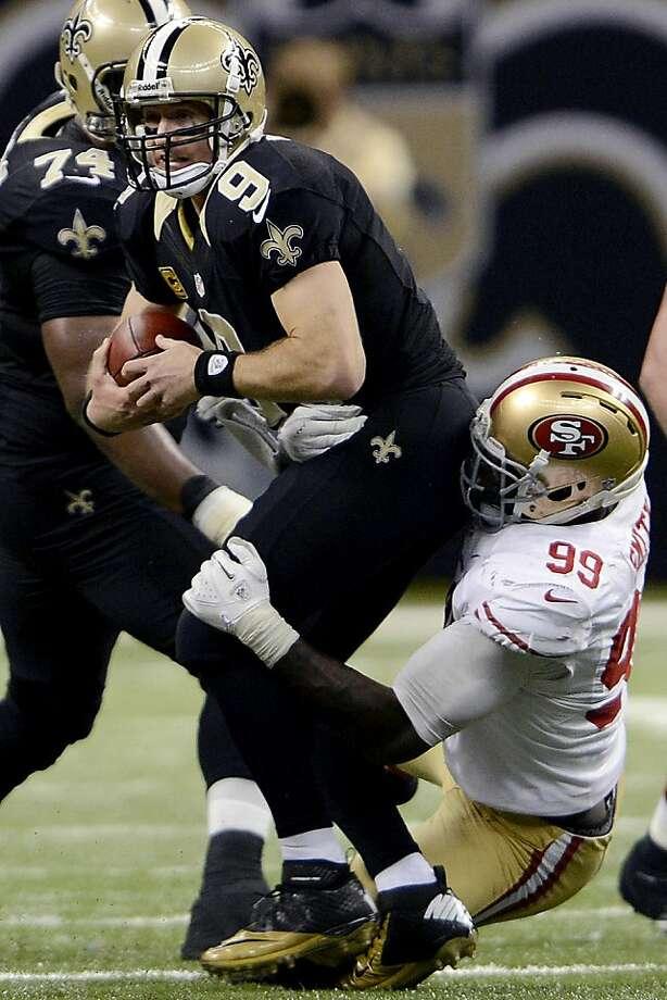 Aldon Smith sacks the Saints' Drew Brees on Sunday. Smith had nine sacks in November. Photo: Bill Feig, Associated Press