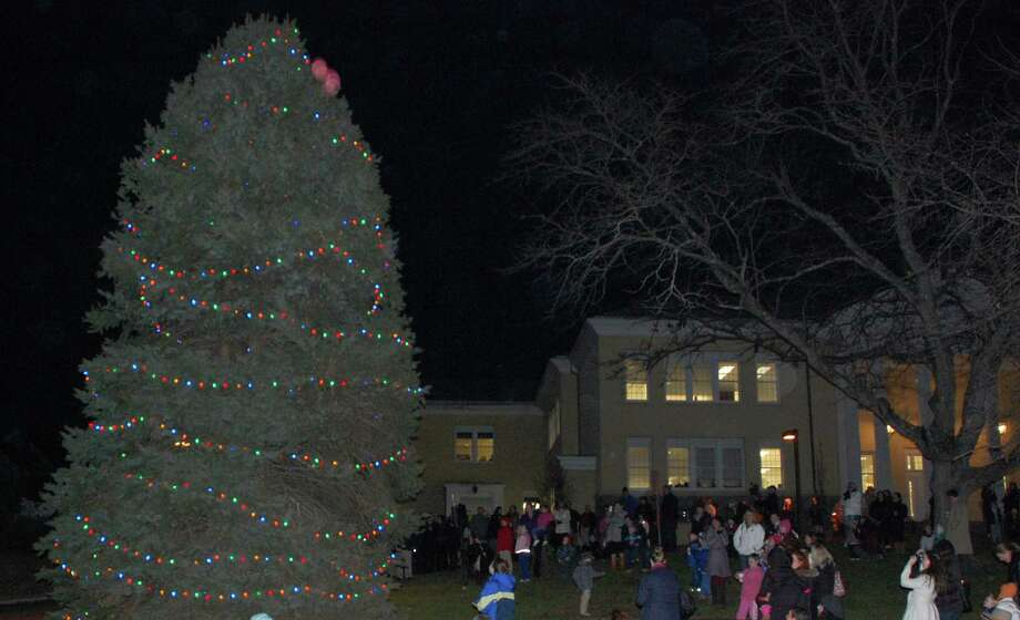 The town's Christmas tree in front of Town Hall was lighted for the season with a brief ceremony Thursday evening.  Westport CT 11/29/12 Photo: Jarret Liotta / Westport News contributed