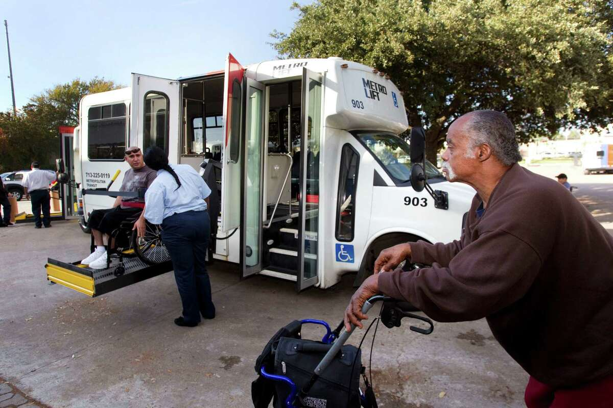 """Ben Stevenson waits to board a MetroLift bus Thursday at the West Gray Multipurpose Center. The late Della Jones, who was blind, talked of """"waging battle against the forces of MetroLift"""" to get decent service."""