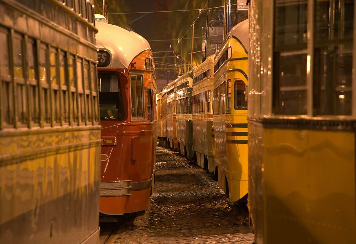 Streetcars bunched up along the Embarcadero waiting out an electricity outage. Photos by Kevin Sheridan to celebrate the 100th anniversary of the Municipal Railway.