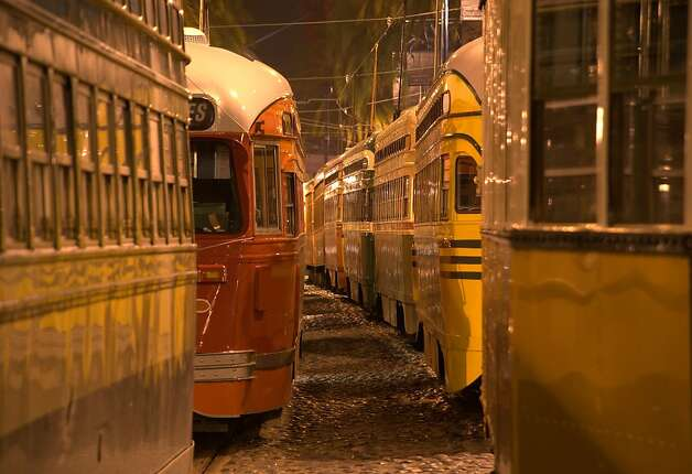 In one photo of an exhibit by Kevin Sheridan and Tim Baskerville, streetcars are bunched up along the Embarcadero during an electricity outage. Photo: Kevin Sheridan, Photographer
