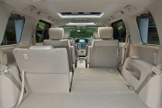 The 2013 Nissan Quest is a roomy and comfortable minivan with  an interior perfectly suited for everyday use or family vacations, including a 60/40-split bench seat with fold-flat capability in the rear. Photo: Nissan, Nissan North America Inc. / © 2012 Nissan