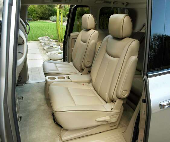 The 2013 Nissan Quest is a roomy and comfortable minivan with  an interior perfectly suited for everyday use or family vacations, including a dual captainÕs chairs in the second row. Photo: Nissan, Nissan North America Inc. / © 2012 Nissan