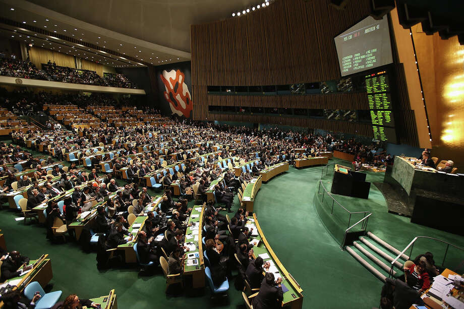 """NEW YORK, NY - NOVEMBER 29:  Members of the UN General Assembly applaud after voting in favor of a UN resolution on Palestine on November 29, 2012 in New York City. The resolution granting granting """"non-member observer"""" status to a Palestinian state was approved by the 193-member body by a vote of 138-9 with 41 abstentions. The United States, Israel, Canada and a handful of others voted against Thursday's historic UN resolution. Photo: John Moore, Getty Images / 2012 Getty Images"""