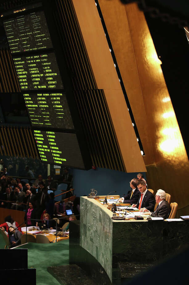 "NEW YORK, NY - NOVEMBER 29:  A signboard posts the vote in favor of a UN resolution on Palestine on November 29, 2012 in New York City. The resolution granting ""non-member observer"" status to a Palestinian state was approved by the 193-member body by a vote of 138-9, with 41 abstentions. The United States, Israel, Canada and a handful of others voted against Thursday's historic UN resolution. Photo: John Moore, Getty Images / 2012 Getty Images"