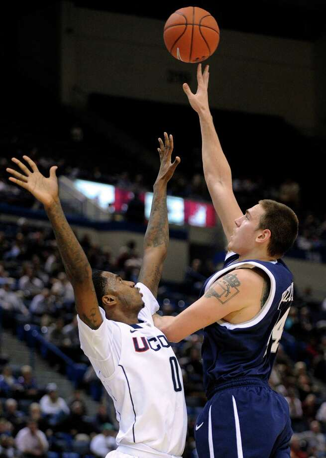 New Hampshire's Chris Pelcher, left, shoots over Connecticut's Phillip Nolan during the first half of an NCAA college basketball game in Storrs, Conn., Thursday, Nov. 29, 2012. (AP Photo/Fred Beckham) Photo: Fred Beckham, Associated Press / FR153656 AP