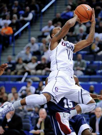 Connecticut's Ryan Boatright drives against New Hampshire during the first half of an NCAA college basketball game in Storrs, Conn., Thursday, Nov. 29, 2012. (AP Photo/Fred Beckham) Photo: Fred Beckham, Associated Press / FR153656 AP