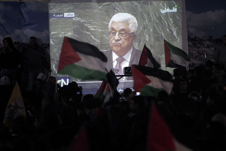 Palestinians watch on a giant screen Palestinian President Mahmoud Abbas speaking at the UN on Novem