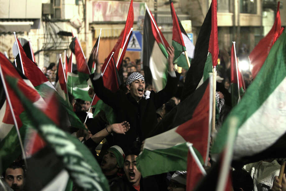 Palestinians celebrate in the West Bank city of Ramallah on November 29, 2012 after the General Assembly voted to recognise Palestine as a non-member state. The UN General Assembly on Thursday voted overwhelmingly to recognize Palestine as a non-member state, giving a major diplomatic triumph to president Mahmud Abbas despite fierce opposition from the United States and Israel. AFP PHOTO/AHMAD GHARABLI Photo: AHMAD GHARABLI, AFP/Getty Images / 2012 AFP