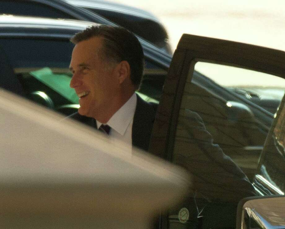 Former Republican presidential candidate Mitt Romney arrives at the White House in Washington, Thursday, Nov. 29, 2012, for his luncheon with President Barack Obama. (AP Photo/Pablo Martinez Monsivais) Photo: Pablo Martinez Monsivais