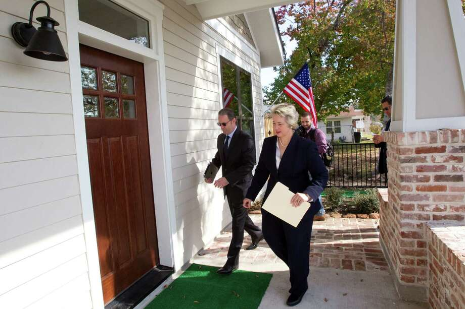 "David Goswick, left, CEO of HOUZE, walks with Mayor Annise Parker to the front door of one of the new ""zero energy"" homes built by HOUZE in Independence Heights Thursday, Nov. 29, 2012, in Houston. Photo: Brett Coomer, Houston Chronicle / © 2012 Houston Chronicle"