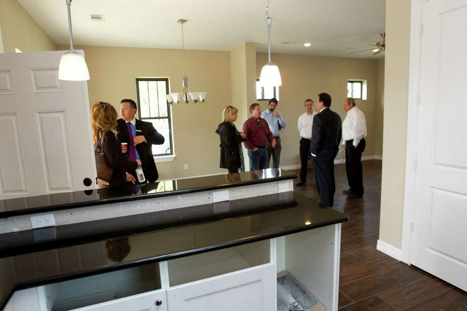 "Visitors tour one of two new ""zero energy"" homes by HOUZE in Independence Heights Thursday, Nov. 29, 2012, in Houston. Photo: Brett Coomer, Houston Chronicle / © 2012 Houston Chronicle"