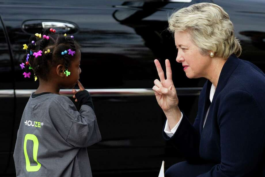 """Mayor Annise Parker, right, talks to Knaja Simone during the unveiling of a pair of """"zero energy"""" homes by HOUZE in Independence Heights Thursday, Nov. 29, 2012, in Houston. Photo: Brett Coomer, Houston Chronicle / © 2012 Houston Chronicle"""