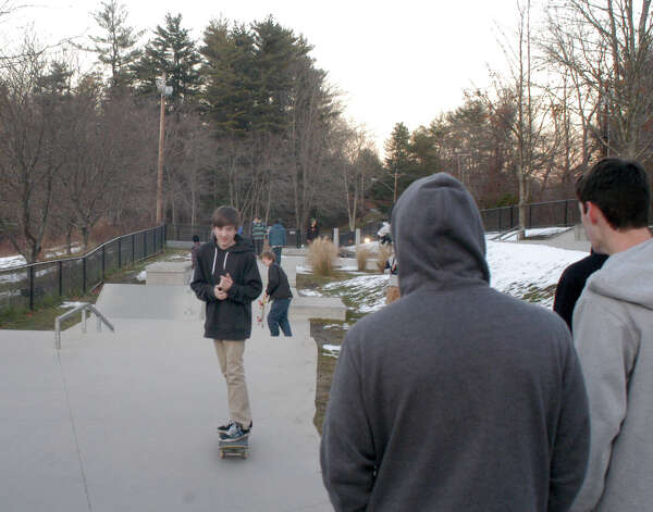 People gather at the skatepark in Newtown on Thursday to remember Chris Mulligan, a former Newtown High School student, after he was killed while crossing Route 25 Wednesday. Photo: John Pirro / The News-Times