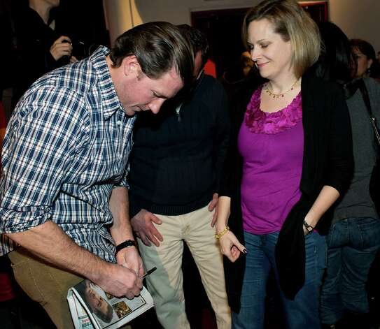 "Filmmaker/actor Ed Burns signs autographs for audience members following the screening of his new film ""The Fitzgerald Family Christmas"" at the Avon Theatre, Stamford CT on Wednesday November 28th, 2012. Photo: Mark Conrad / Stamford Advocate Freelance"