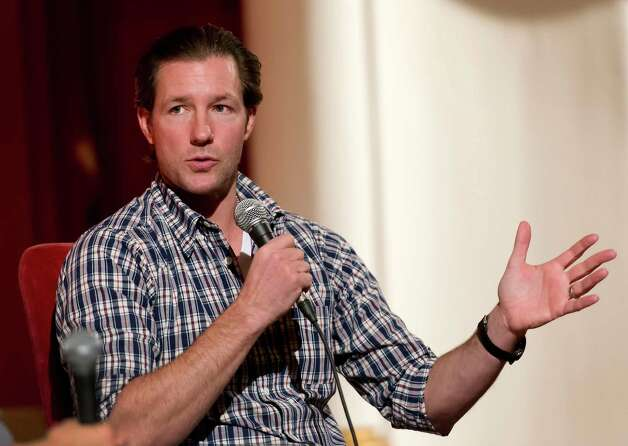 "Filmmaker/actor Ed Burns answers questions about his new film ""The Fitzgerald Family Christmas"" to an audience who just viewed his film at the Avon Theatre, Stamford CT on Wednesday November 28th, 2012. Moderating the event was Avon Theatre director of communications, Bridget Stokes. Photo: Mark Conrad / Stamford Advocate Freelance"