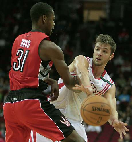 Chandler Parsons, right, willingly concedes crisp passing and ball movement have become a lost art during the Rockets' tailspin of the past two weeks. Photo: James Nielsen, Staff / © Houston Chronicle 2012