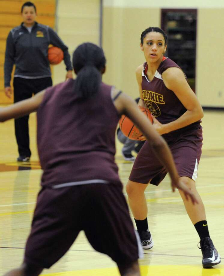 Colonie basketball player Sydnie Rosales look for an open player to pass the ball to during a drill at practice on Thursday Nov. 29, 2012 in Colonie, N.Y.  (Lori Van Buren / Times Union) Photo: Lori Van Buren