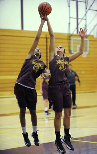 Colonie basketball player Sydnie Rosales, right, goes up for a rebound during a drill at practice on