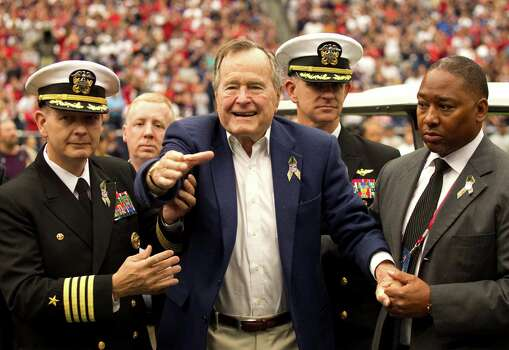 A now-ailing former President George H.W. Bush arrives for the coin toss before the Texans' game against the Buffalo Bills on Nov. 4. Photo: Brett Coomer, Staff / © 2012  Houston Chronicle