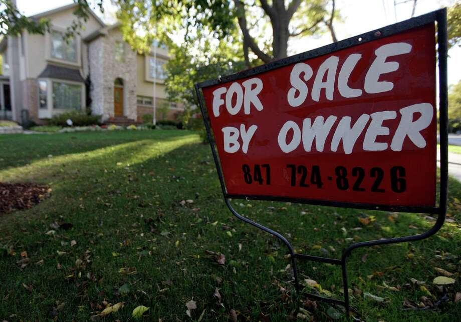 FILE - This Wednesday, Oct. 10, 2012  file photo shows a for-sale sign at a home in Glenview, Ill.An index measuring the number of Americans who signed contracts to buy homes in October jumped to nearly its highest level in almost six years. Steady job gains and record-low mortgage rates have made home buying more attractive. (AP Photo/Nam Y. Huh, File) Photo: Nam Y. Huh