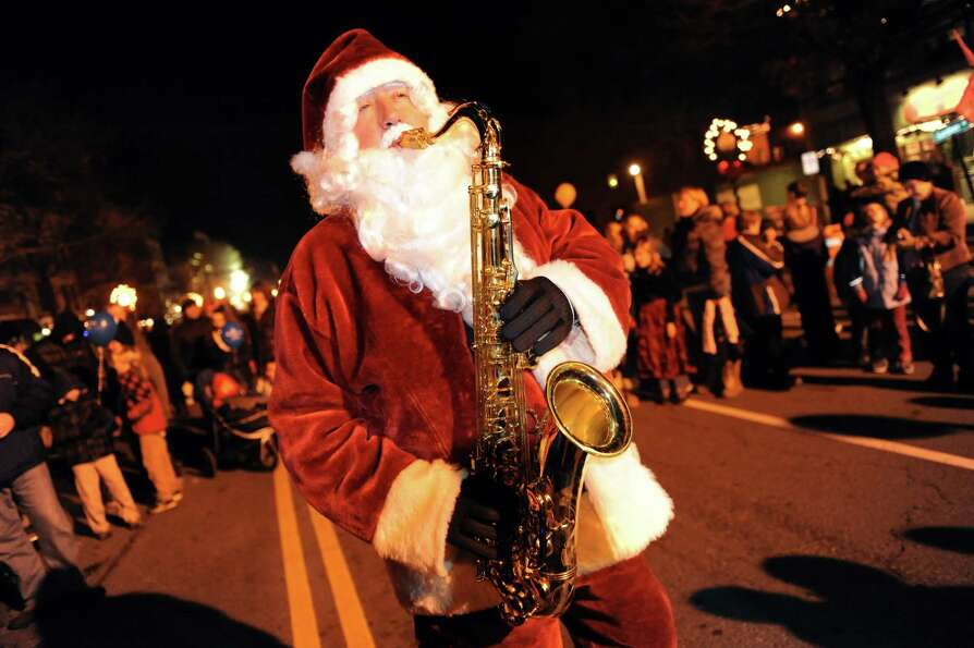 Luke McNamee of Saratoga Springs performs as Sax-o-Claus during the Victorian Streetwalk on Thursday