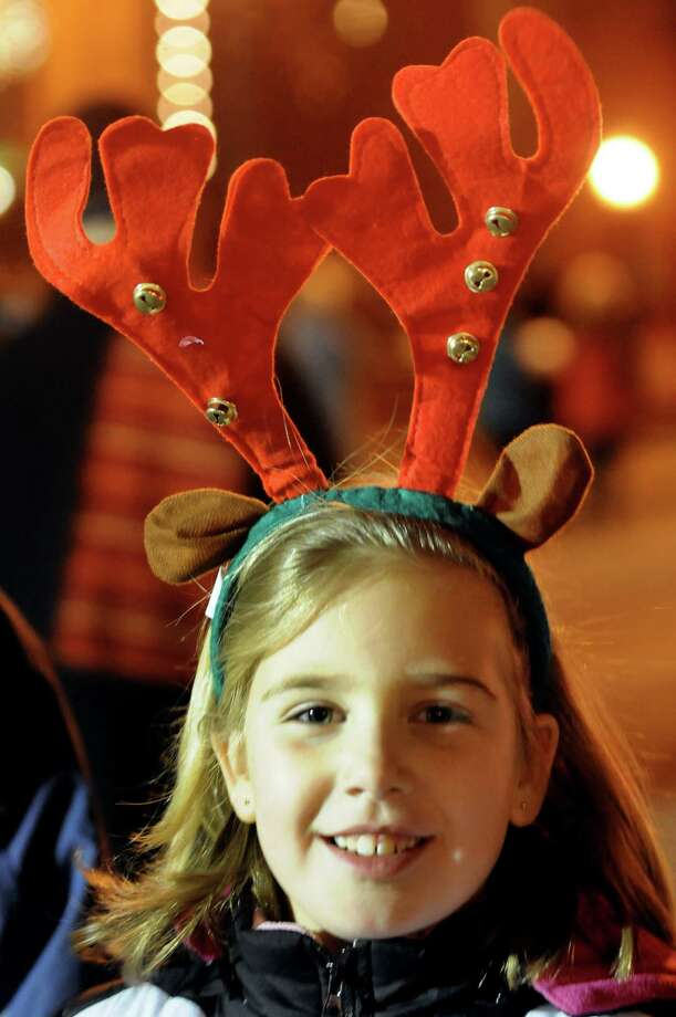 Erin O'Connor, 7, of Malta wears her reindeer antlers during the Victorian Streetwalk on Thursday, Nov. 29, 2012, on Broadway in Saratoga Springs, N.Y. (Cindy Schultz / Times Union) Photo: Cindy Schultz /  00020251A
