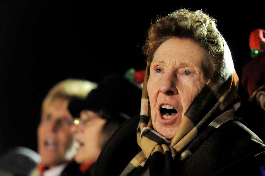 Maria Ross of Warrensburg sings along to the Christmas songs performed by the Saratoga Abundant Life Church during the Victorian Streetwalk on Thursday, Nov. 29, 2012, on Broadway in Saratoga Springs, N.Y. (Cindy Schultz / Times Union) Photo: Cindy Schultz /  00020251A
