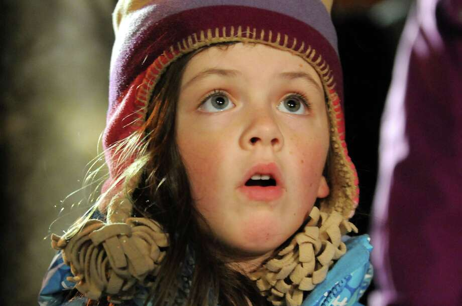 Ainsley Meyer, 5, of Wilton watches with awe the Saratoga Abundant Life Church music program during the Victorian Streetwalk on Thursday, Nov. 29, 2012, on Broadway in Saratoga Springs, N.Y. (Cindy Schultz / Times Union) Photo: Cindy Schultz /  00020251A