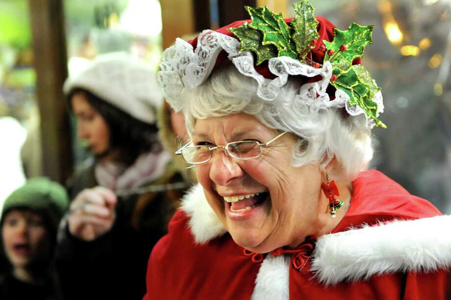 Mrs. Claus, also known as Joann McGraw of Saratoga Springs, entertains the crowd during the Victorian Streetwalk on Thursday, Nov. 29, 2012, on Broadway in Saratoga Springs, N.Y. (Cindy Schultz / Times Union) Photo: Cindy Schultz /  00020251A