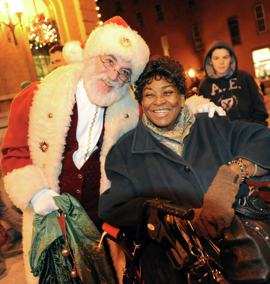 Santa Claus, also known as Joseph Paviglianiti of Malta, left, poses for a picture with Dorothy Reid of Granville during the Victorian Streetwalk on Thursday, Nov. 29, 2012, on Broadway in Saratoga Springs, N.Y. (Cindy Schultz / Times Union) Photo: Cindy Schultz /  00020251A