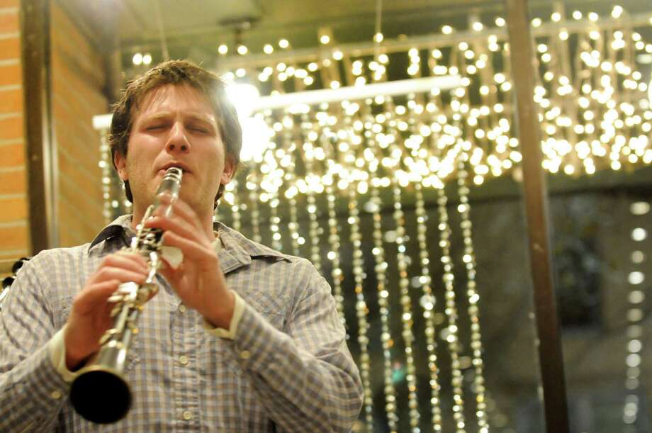 Jonathan Greene of Saratoga Springs joins other musicians as he plays the clarinet inside a shop during the Victorian Streetwalk on Thursday, Nov. 29, 2012, on Broadway in Saratoga Springs, N.Y. (Cindy Schultz / Times Union) Photo: Cindy Schultz /  00020251A