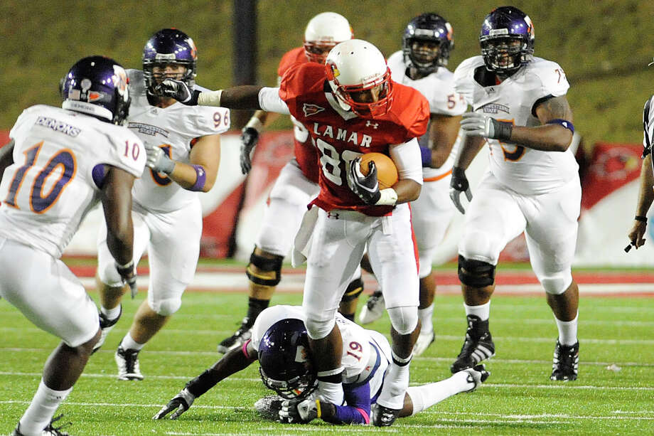 Lamar wider receiver J.J. Hayes tries to break away from a pack of  Northwestern State defenders during their game at Provost Umphrey Stadium. Saturday, October 8, 2011.  Valentino Mauricio/The Enterprise Photo: Valentino Mauricio