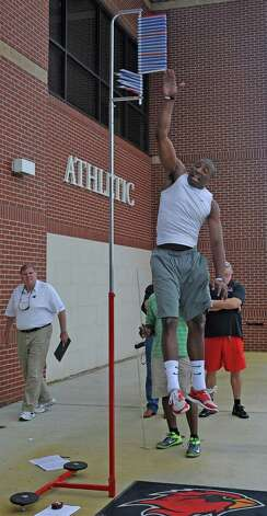 As the scouts watch, J.J. Hayes does his second attempt at the vertical jump reaching 33 1/2 inches.   Lamar University football seniors J.J.Hayes, Darby Jackson, and Marcus Jackson along with others, had a chance to do football-related drills in front of nine National Football League scouts Wednesday afternoon on the playing field. Dave Ryan/The Enterprise Photo: Dave Ryan