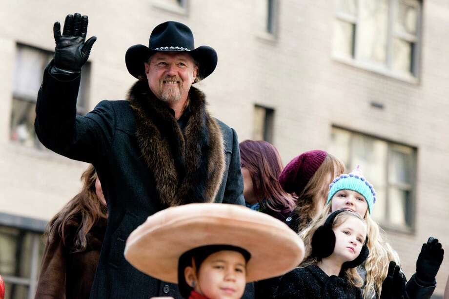 FILE - In this Thursday, Nov. 22, 2012 file photo, Trace Adkins rides a float in the Macy's Thanksgiving Day Parade in New York. Trace Adkins wore an earpiece decorated like the Confederate flag when he performed for the Rockefeller Center Tree Lighting on Nov. 28, but he said he didn't mean to offend anyone by wearing it. (AP Photo/Charles Sykes, File) Photo: Charles Sykes, Associated Press / AP